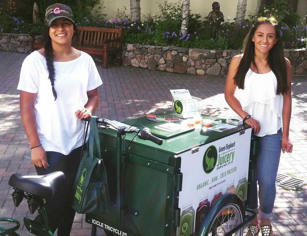 two smiling people with a green frame custom branded ice cream bike
