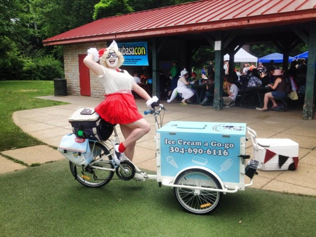 A clown riding a branded Ice Cream Bike/ Trike at a convention