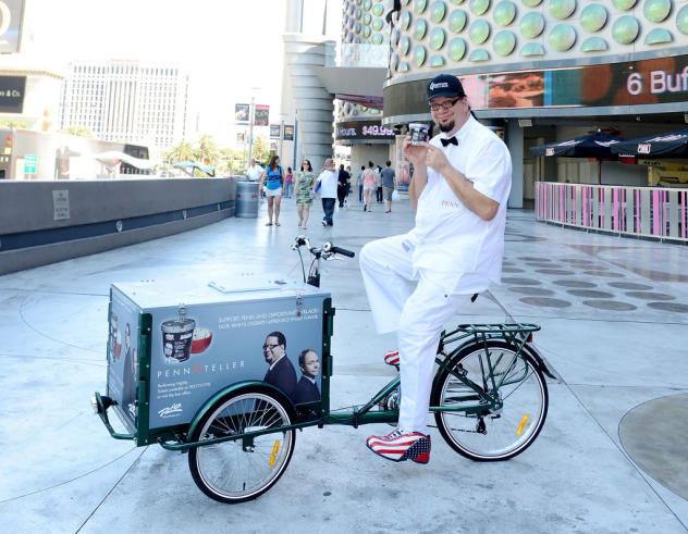 Penn posing with Penn & Teller Ice Cream on an Icicle Tricycles Ice Cream Bike Cart in Las Vegas