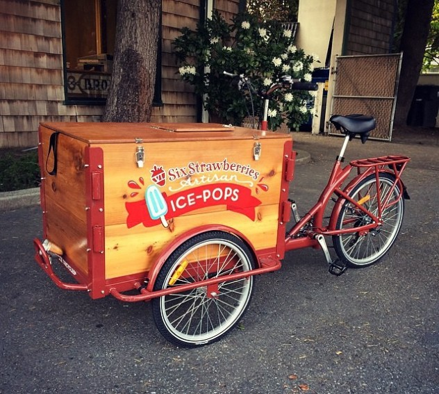 a cedar cargo box icicle tricycles Popsicle ice cream food bike / trike with a red frame branded for six strawberries bike