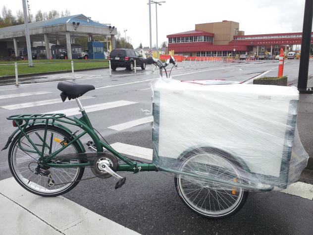 Icicle Tricycles Used Ice Cream Bike / trike partially packaged and parked at the curb by a ferry port in Washington