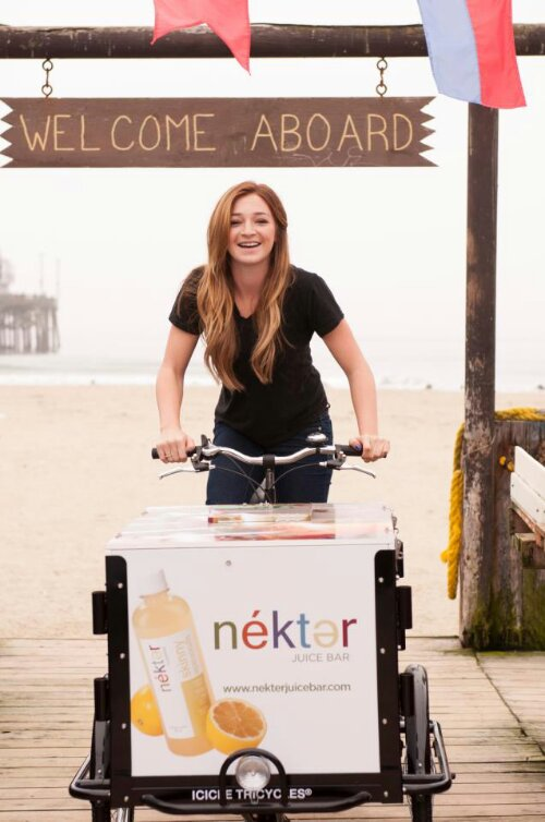 Icicle Tricycles Experiential Marketing Ice Cream Bike being ridden down a pier. Custom Wrap Nekter.