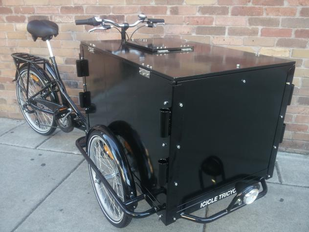 an All Black Icicle Tricycles Audiovisual Services Bike