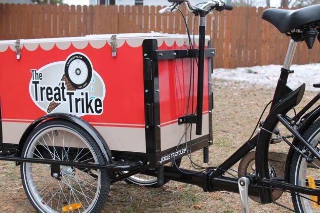 Icicle Tricycles Ice Cream Bike / Trike with a black frame branded for The Treat Trike parked in a snowy back yard