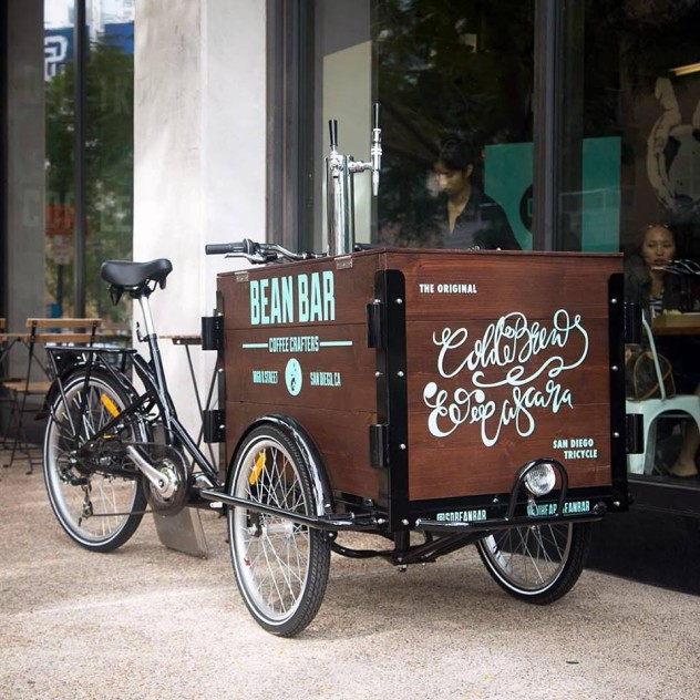 hand painted branded for Bean Bar custom cedar box Cold Brew Bike parked on the sidewalk