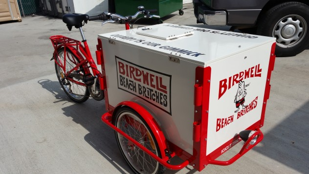 An icicle Tricycles Ice Cream bike with a red frame and a graphic printed box.