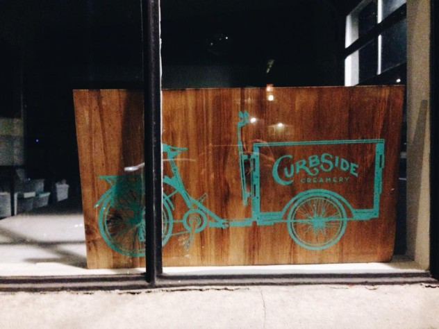 A Icicle Tricycles Cedar Wood Ice Cream Bike / Trike sign for Curbside Creamery
