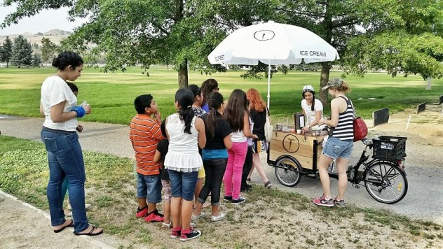 children lining up at a Icicle Tricycles Ice Cream Bike / Trike branded for IceCycle Creamery