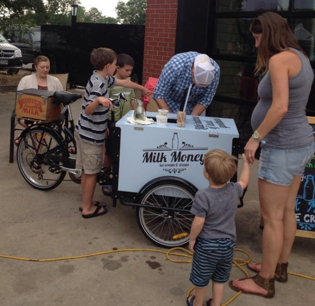 Serving Ice cream to kids from an Icicle Tricycles Milk and Honey branded Ice Cream Bike / Trike
