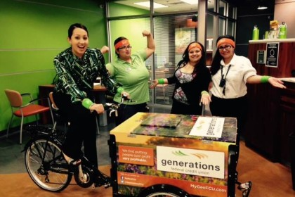 people making funny sports poses in a credit union with a generations credit union branded icicle tricycles bank bike marketing advertising bikes