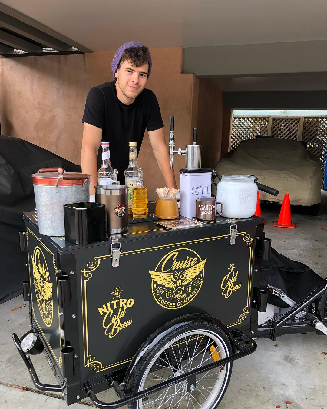 Nitro Cold Brew Coffee Cart vendor set up and smiling