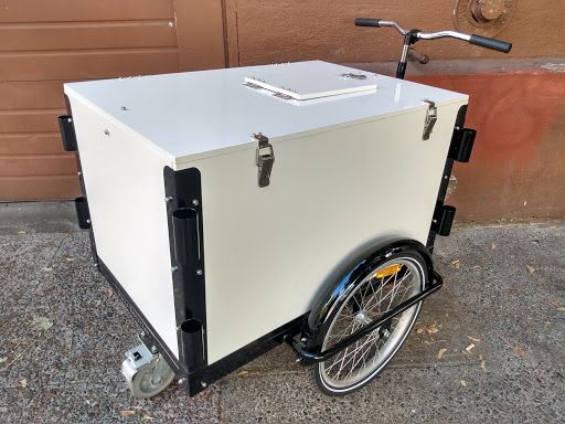An Icicle Tricycle Ice Cream Cart with a gloss white cargo box and black frame