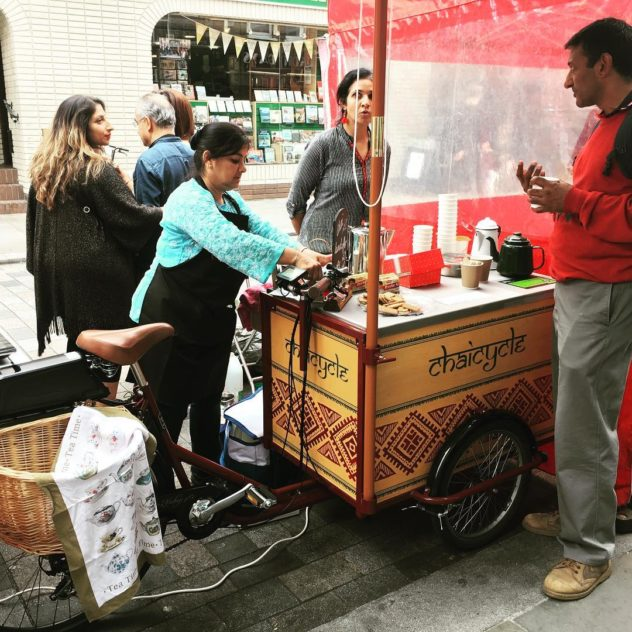 Icicle Tricycles Ice Cream Bike Food Cart setup in a busy market being used to sell indian cuisine
