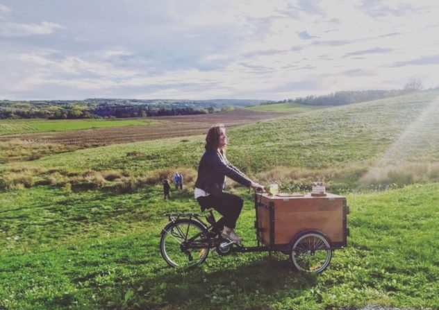 Wedding planner riding a custom cedar wood box ice cream bike in the hills of Halifax